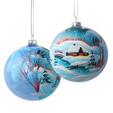 Two Christmas Balls on White. Two Christmas balls  with drawing freehand rustic winter landscape isolated on white background. Focus on front ball Stock Photography