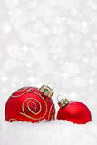 Two christmas baubles with bokeh light effect. In background Stock Photos
