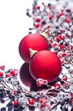 Two Christmas baubles and holly berries Royalty Free Stock Images