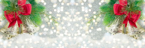 Two Christmas bells decoration on festive lights Royalty Free Stock Image