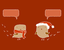 Two Christmas birds with speech bubbles. Stock Images
