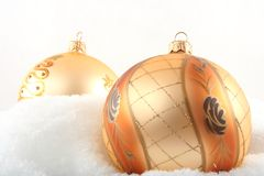 Two Christmas bulbs in the snow Stock Photos