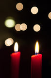Two Christmas candles Stock Photography