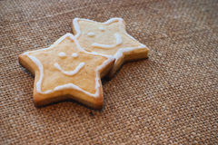 Two christmas cookies on the flax texture #2 Royalty Free Stock Photography