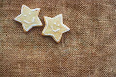 Two christmas cookies on the flax texture Royalty Free Stock Photo