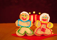 Two Christmas cookies holding hands Stock Image