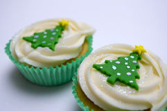 Two Christmas cup cakes Stock Photos