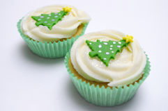 Two Christmas cup cakes Stock Images