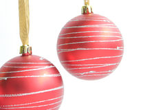 Two christmas decorations. Two red christmas decorations over white back ground Royalty Free Stock Image