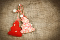 Two Christmas decorations on canvas background royalty free stock image