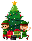 Two christmas elves under christmas tree Stock Image