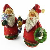Two christmas figurine of santa claus. Isolated on white background Royalty Free Stock Images