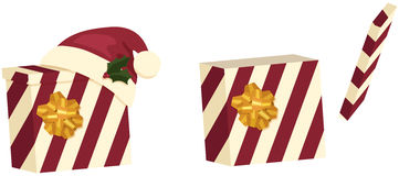 Two Christmas Gift Boxes. Two red and beige striped Christmas gift boxes, one closed and one open, decorated with a Santa hat, bows, and holly Stock Image