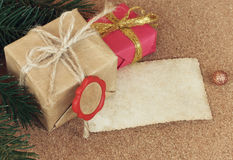 Two Christmas gift with a red seal on cork board Stock Images