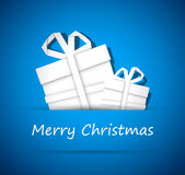 Two christmas gift from white paper. New year card, blue background royalty free illustration