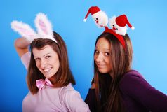 Two Christmas girls. Royalty Free Stock Photography