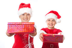 Two christmas girls holding gifts Royalty Free Stock Photography