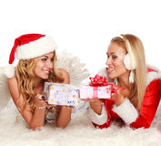 Two Christmas girls on the white carpet,with presents Royalty Free Stock Image