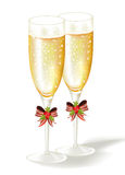 Two Christmas glasses of champagne. Royalty Free Stock Image