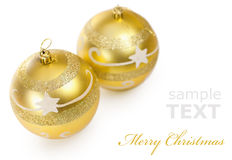 Two Christmas golden balls. Isolated on white background with copy space for text Royalty Free Stock Image