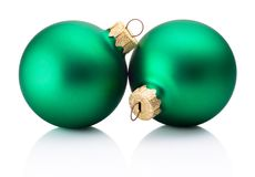 Two Christmas green baubles isolated on white background. Two Christmas green baubles isolated on a white background stock image