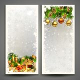 Two Christmas greeting cards with gifts and pine cones. Stock Images