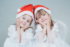 Two christmas little girls Royalty Free Stock Photos