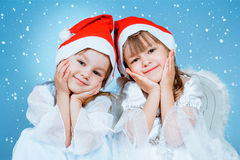 Two christmas little girls Stock Photos
