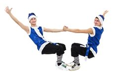 Two Christmas men in blue santa clothes dancing against isolated white in full length. Stock Photography
