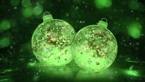 Two Christmas Green Ice Glass Baubles snowflakes colorful petals background loop
