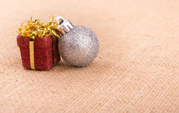Two Christmas ornaments on burlap Royalty Free Stock Photo