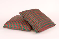 Two Christmas Pillows. Isolated View of Two Christmas Pillows Stock Photos