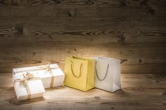 Two christmas presents and two shopping bags stock photography