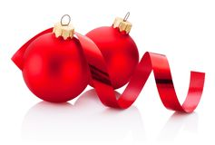 Two Christmas red bauble and curling paper Isolated on white. Two Christmas red bauble and curling paper Isolated on a white background stock photography