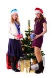Two Christmas santa girl with gift royalty free stock image