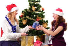 Two Christmas santa girl with gift Royalty Free Stock Images