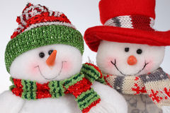 Two christmas snowmen. Doll christmas snowmen  on white Royalty Free Stock Image