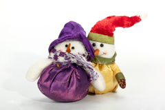 Two Christmas Snowmen with Brightly Colored Clothes Royalty Free Stock Photos