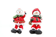 Two Christmas Snowmen. A pair of snowmen figurine for the Christmas holiday Royalty Free Stock Photos