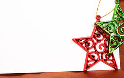 Two Christmas star decorations and card. Two Christmas star decorations and white card with copy space Stock Photo