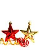 Two Christmas stars and ribbon isolated on white Stock Photo