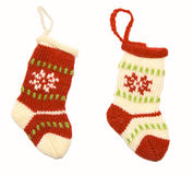 Two Christmas stockings. Two colorful, knitted Christmas socks with loops for hanging. Shot against a white background Stock Photos