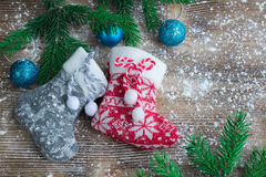 Two Christmas stockings on snowbound wooden background, blue bal Royalty Free Stock Photography