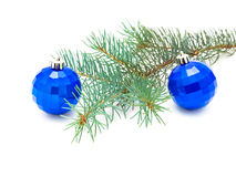 Two Christmas toys and ate branch. Closeup on white background Royalty Free Stock Images