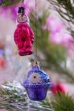 Two christmas toys on tree basket closeup colorful royalty free stock photos