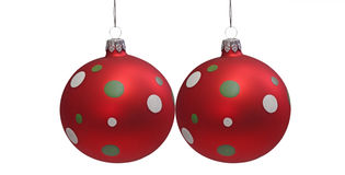 Two Christmas Tree Balls. Two red christmas tree balls with spots, isolated on white background Stock Image