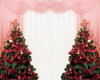 Two Christmas tree and curtains Royalty Free Stock Photos