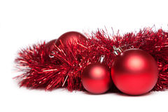 Two christmas tree toys with red garland Stock Photos