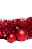 Two christmas tree toys with red garland Royalty Free Stock Photography