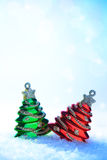 Two Christmas tree on white snow Stock Images